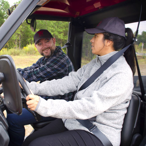 Hispanic female in driver seat of YANMAR UTV